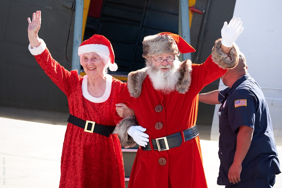 "Santa And Mrs. Claus Arriving In His C-47 ""What's Up Doc?"""