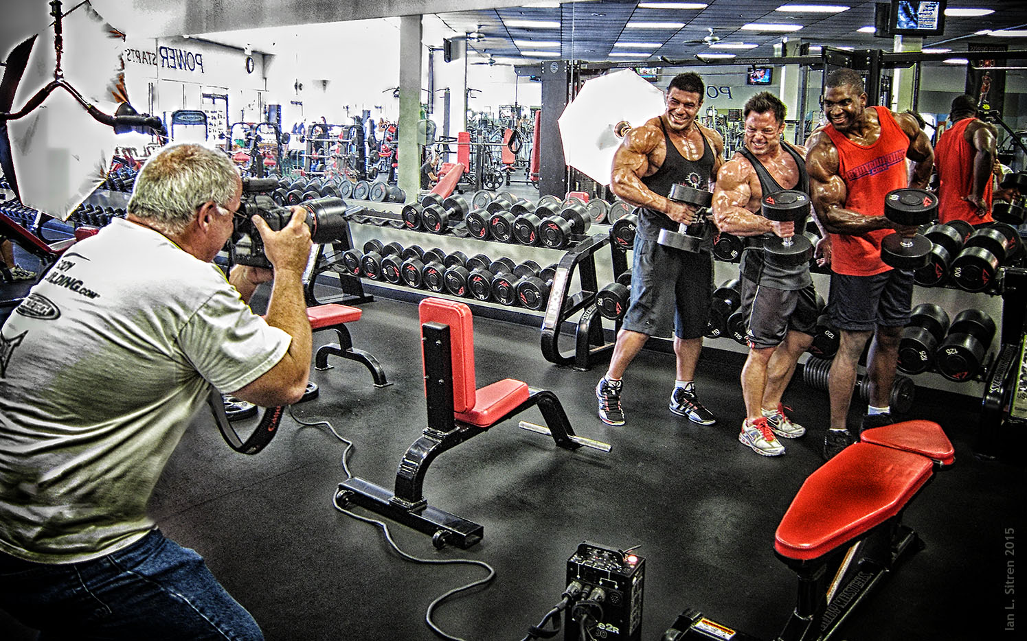 Bodybuilders Xavisus Gayden, Grant Pieterse and Jake Sawyer working out during our photo shoot in the gym
