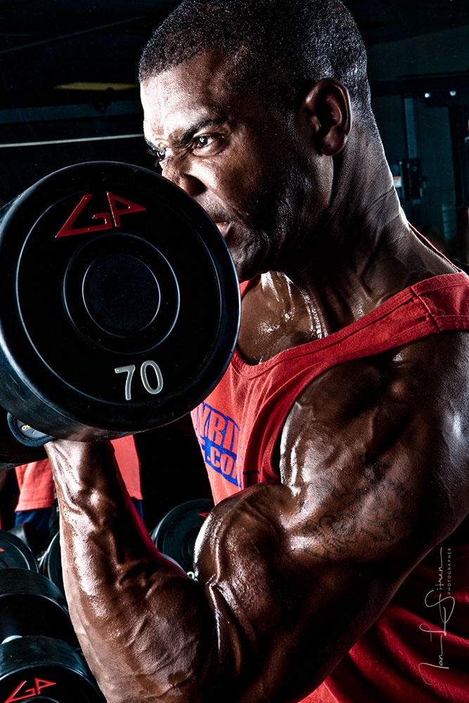 Bodybuilders Xavisus Gayden working out during our photo shoot in the gym